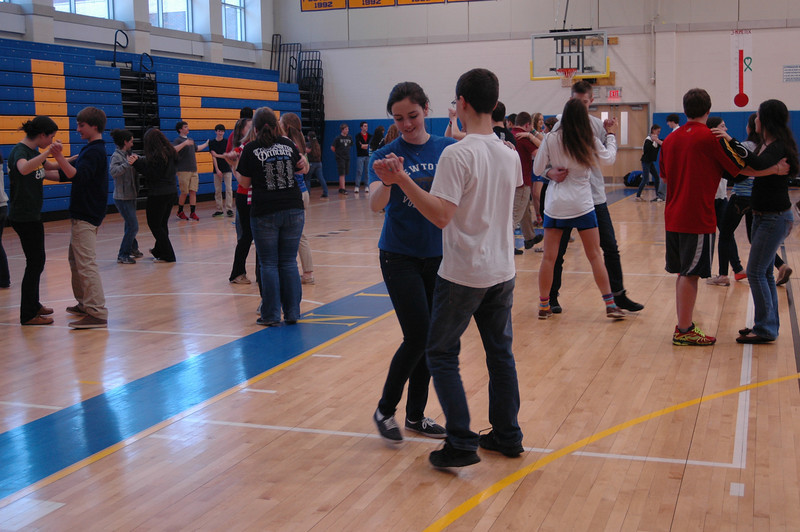 Newtown High School students Taylor Stroili, center left, and Kai Hedin danced during Argentina Day held on Thursday, April 4.   (Hallabeck photo)