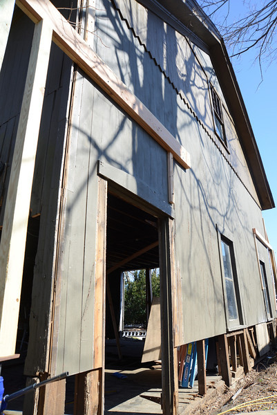 Temporary supports on either end of the building help keep its sagging side lifted, relieving pressure causing the wall to sag and bow.   (Bobowick photo)