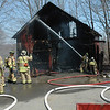 Volunteer firefighters from all five local fire companies responded to a barn fire midday on Tuesday, April 9, at 64 Main Street. The blaze destroyed the barn and most of its contents. There were no injuries. (Gorosko photo)
