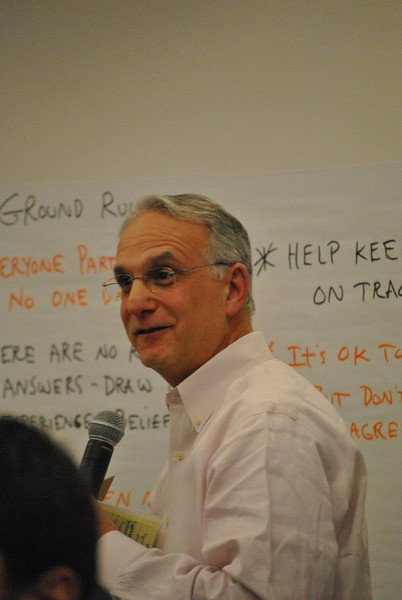 Richard Harwood, of The Harwood Institute out of Bethesda, Md., leads the group of town representatives through the rules that will apply during the meetings he is charged with facilitating, at the first of five scheduled meetings on April 5.   (Crevier photo)