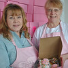It is all about cupcakes for owner Sherry Nash, left, and her sister, Carrie Chapin, at Cherries Cupcakes on South Main Street.   (Crevier photo)