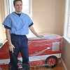 Pediatrician Richard Auerbach gets ready to unwrap a fire engine exam table for his new practice at 25 Church Hill Road. He hopes that the fun table will be one of many features that puts his young patients at ease.   (Crevier photo)