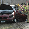 Newtown Hook & Ladder volunteer firefighters responded to a two-vehicle accident about 5:27 pm on April 4 at the intersection of Schoolhouse Hill Road and Edmond Road, near an Interstate 84 overpass. Firefighters extricated a motorist from a vehicle involved in the collision. Police said that motorist Ferdinand J. Metzger III, 31, of Bellevue, Nev., who was driving a 2006 Scion sedan, pulled out of a commercial driveway and then collided with motorist Teresa Dahlmeyer, 29, of 15 Sunnyview Terrace, who was driving a 2003 Pontiac Aztek SUV. Newtown Volunteer Ambulance Corps members transported Dahlmeyer to Danbury Hospital to be treated for injuries, police said. Police said they issued Metzger an infraction for failure to grant the right of way and for failure to carry an automotive insurance identification card.   (Gorosko photo)
