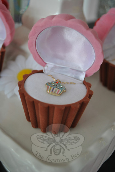 A child's necklace featuring a rhinestone-studded cupcake is among the novelty items sold at Cherries Cupcakes.   (Crevier photo)