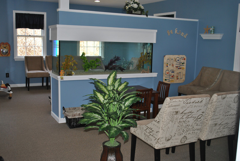 """Be Kind"" is the theme of the waiting area and aquarium at Auerbach Pediatrics, which opened recently at 25 Church Hill Road.   (Crevier photo)"