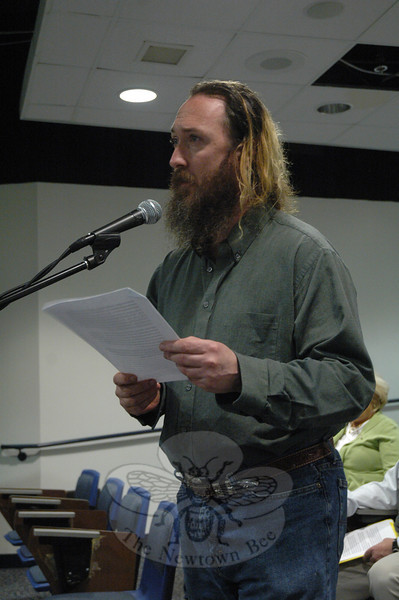Resident Aaron Cox of Pond Brook Road registered his views on target shooting on April 11 at a session held by the Ordinance Committee of the Legislative Council.  (Gorosko photo)