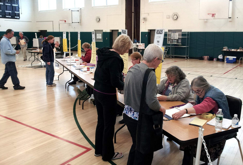 By 6 pm Tuesday, with just two hours before polls closed, 3,421 residents had converged on Newtown Middle School to cast ballots for the 2013-14 townwide budget. But by 8:20 pm, of-ficials had learned that both the town and school budget requests were rejected by voters.   (Voket photo)
