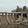 A tractor-trailer truck travels on the Route 34 bridge atop Stevenson Dam, crossing the Housatonic River from Monroe to Oxford. The state Department of Transportation has put on hold a proposal to build a new Route 34 bridge across the river to replace the two-lane bridge positioned on top of the hydroelectric dam.   (Gorosko photo)