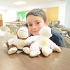 Aiden Braddock plans to send his monkeys, Chicken and Nugget, to other children who may need them. He stuffed and dressed the toys April 13 during a free workshop in  Sandy Hook.   (Bobowick photo)
