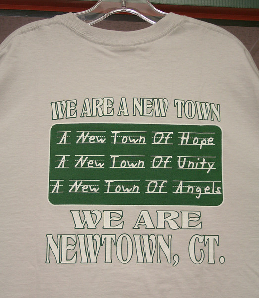 Bridgeport firefighters have been selling T-shirts that honor, as the back of the shirt indicates, hope, unity, and angels of Newtown.  (Hicks photo)