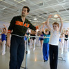 Mr Fairchild helps a student improve his position during a special master class at The Graceful Planet on April 22.   (Bobowick photo)