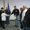 Mikayla Bonilla shakes the hand of Sandy Hook Fire & Rescue Engineer Rob Sibley.   (Hicks photo)