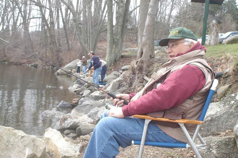 """Fred Frillici, a member of the Newtown Fish and Game Club, casts his line and looks to reel in a fish during Opening Day at Taunton Lake on April 20. The Fairfield resident was far from the only one who sought to make a catch in the club-owned 126-acre lake stocked with trout.   (Hutchison photo)<br /> <br /> Please see this week's Sports Photos for additional images from opening day: <a href=""""http://photos.newtownbee.com/Sports/Sports-photos-for-week-146/29095199_XH5gvD#!i=2476706136&k=pcChmv9"""">http://photos.newtownbee.com/Sports/Sports-photos-for-week-146/29095199_XH5gvD#!i=2476706136&k=pcChmv9</a>"""