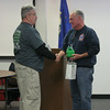 Bridgeport Firefighter Paul Neugebauer also presented Chief Halstead with a gift on behalf of his company. Mr Neugebauer handed over a box of helmet stickers, similar to the ones Bridgeport firefighters hope to share with at least three local high schools in upcoming months.  (Hicks photo)