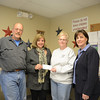 The Sandy Hook Organization for Prosperity (SHOP) members have established a fund through Newtown Scholarship Association (NSA), and made a $500 contribution this week. The scholarship, which will be awarded for the first time, this year is intended to support a Sandy Hook resident majoring in business studies. SHOP hopes to award the scholarship annually. From left, SHOP Vice President Joe Hemingway presents the check to Stephanie Gaston along with SHOP member and PJ's Laundromat owner Sharon Doherty and NSA President Julie Savino.   (Bobowick photo)