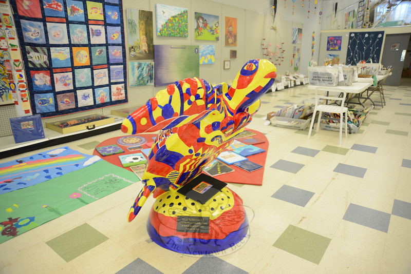 A gift to Newtown from Surfside Florida and the Ruth K Broad K-8 Center, dated February 14, 2013, is a large turtle sculpture that stands toward the back of HealingNewtown at 5 Queen Street.   (Bobowick photo)