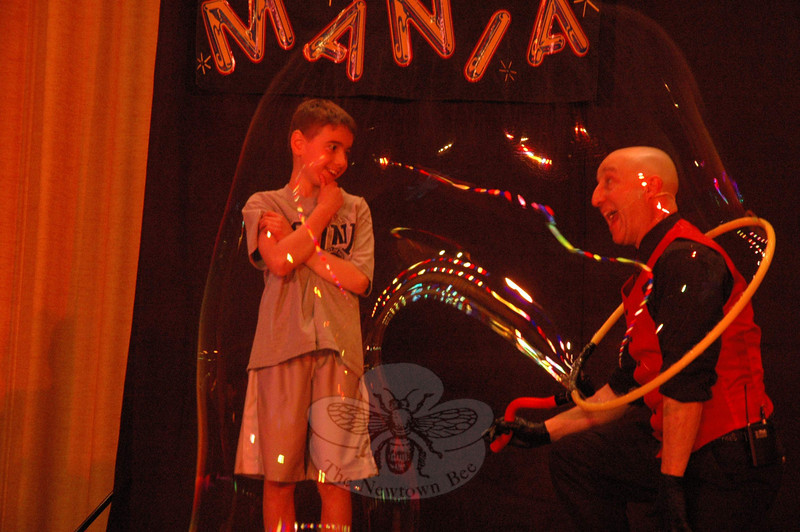 A performance of Casey Carle's BubbleMania was staged on Saturday, April 27, at Edmond Town Hall. The show combined visual comedy, quick wit, science, art, and humor. The performance, sponsored by the Newtown Junior Women's Club, was a fundraiser for the group and for Ben's Bells Newtown. On stage, Casey Carle, right, assisted by Jack, created a huge soap bubble that enclosed both people.  (Gorosko photo)