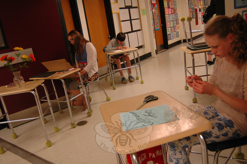 Newtown Middle School students Sarah Dowling, right, Megan Latte, left, Max Filter-Calvo, back, create artwork in the hallway during the school's Celebration of the Arts, Tuesday, April 30.    (Hallabeck photo)
