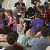 During a Sunday morning service that was filled with activity, this young parishioner at Newtown United Methodist Church seems to have found himself lifted in prayer. The 10 am worship service on April 28 included the welcoming of new members to the Sandy Hook church, the presentation of new devotionals for first responders, and - going on in the background - the blessing of NUMC church members who will be heading to Haiti this weekend. While the church's children laid their hands on those who will be traveling as part of the Mountains of Hope team, this young babe in his mother's arms seemed to be looking toward the heavens (or the church's balcony) for his adoration.   (Hicks photo)