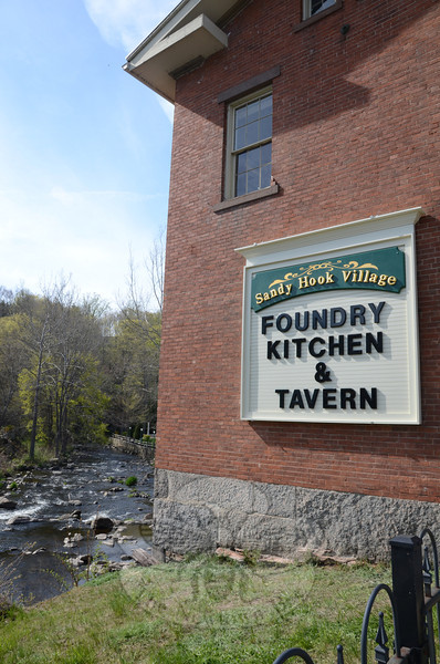 The familiar, historic red brick building above the Pootatuck River in Sandy Hook center is being transformed into a warm and welcoming restaurant and tavern by experienced restaurateur Chris Bruno, formerly of Fiddler's and Chris' American Restaurant in Brookfield.   (Voket photo)
