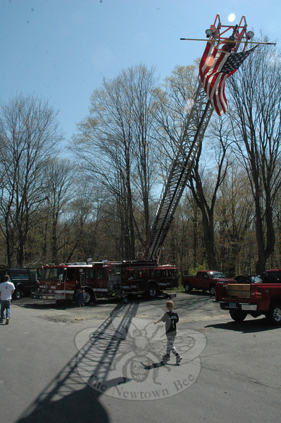 "The Sandy Hook Volunteer Fire & Rescue Company displayed its ""quint"" aerial ladder truck in a parking lot at the Spring Fling business promotion event.   (Gorosko photo)"