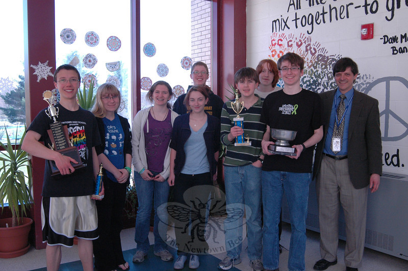 Members of the Newtown High School Chess Club together with trophies and members of its Chess Team on Thursday, April 25.  (Hallabeck photo)