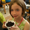 Hawley Elementary School kindergartener Gracie Boyle holds up her planted seed on Friday, April 26, when Stephanie Fagan, the art director of Fine Gardening, published by The Taunton Press, visited with students in Hawley math/science specialist Jenna Connors's classroom.  (Hallabeck photo)