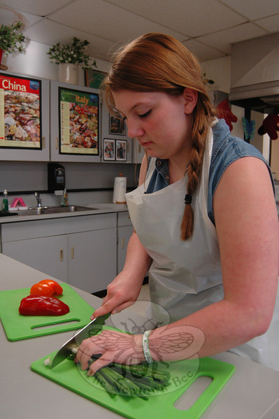 NMS student Lauren Keenan prepares food in the Family and Consumer Science room during the school's Celebration of the Arts.   (Hallabeck photo)