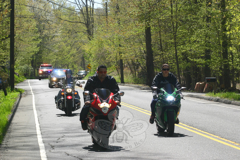"It took just about an hour for approximately 2,000 motorcycles to make their way past each point of The Sandy Hook Green Ribbon Ride route on Sunday.  (Hicks photo)<br /> <br /> PLEASE NOTE: Additional photos from this event, which were presented online in a slideshow, can be viewed here:<br />  <a href=""http://photos.newtownbee.com/Journalism/Special-Events/Sandy-Hook-Green-Ribbon-Ride/29458684_BXBXWC#!i=2516266238&k=8R8PGw5"">http://photos.newtownbee.com/Journalism/Special-Events/Sandy-Hook-Green-Ribbon-Ride/29458684_BXBXWC#!i=2516266238&k=8R8PGw5</a>"