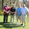 From left, Tom Chickos, Newtown emergency dispatcher Jason Chickos, Patrol Officer Bill Hull, and Dan Ogrodowicz take advantage of a free day of golf at the Newtown Country Club.   (Bobowick photo)