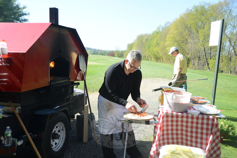 Felix Proto of Red Wagon Pizza bakes pies fresh near the seventh hole for players on the course Sunday, May 5.  (Bobowick photo)