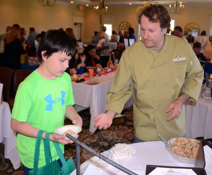 Sal e Pepe owner Angelo Marini dished out samples from his restaurant's kitchen along with nearly a dozen other food vendors as Rock Ridge Country Club hosted the 10th Annual Destination Newtown event May 1.  (Voket photo)