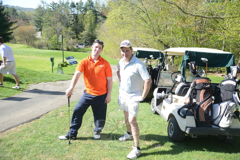 Newtown Hook & Ladder Co. #1 member Tim Hoeffel, left, and President Rick Comejo stand on a hill overlooking the Newtown Country Club course.   (Bobowick photo)