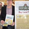"Newtown Economic Development officials were on hand to introduce designer Brent Pruner who donated creative services to the town, including a logo for the EDC's new ""Buy Local First"" campaign.   (Voket photo)"