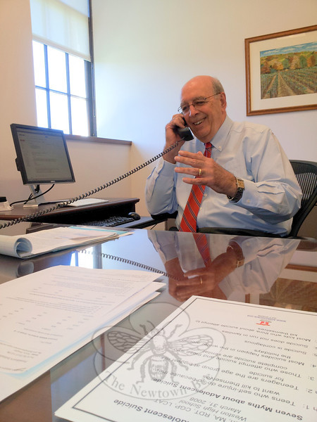Acting Superintendent John Reed takes a call at his desk a few hours into his first day on the job May 6. But a day later he was more reserved during a lengthy video interview with The Bee, during which he candidly discussed myriad challenges he, the district, and the town are facing regarding school matters, the pending budget, and issues post-12/14.   (Voket photo)