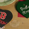 "Newtown residents have been sending well wishes to residents of Boston, following the bombings at the Boston Marathon four weeks ago. In one effort from May 4 until May 11, residents of all ages painted hearts with personalized designs and messages of peace, hope, love, and friendship. These Hears of Hope represent a fraction of those done at a painting party at Newtown United Methodist Church on May 8. Others were done by scouts, members of Newtown Senior Center, and even groups of friends who wanted to pay it forward. Hearts of Hope first arrived in Newtown in February, when volunteers hung hundreds of hearts that had been created by people across the country wanting to send a sign of support here. On Monday, May 14, hundreds of hearts headed to Boston, continuing the act of kindness.   (Hicks photo)<br /> <br /> PLEASE NOTE: Additional photos for this story, which were presented online in a slideshow, can be viewed here: <a href=""http://newtownbee.smugmug.com/Journalism/Special-Events/With-Painted-Ceramic-Hearts/29588277_K95HcF/#!i=2530875896&k=GZVLFV6"">http://newtownbee.smugmug.com/Journalism/Special-Events/With-Painted-Ceramic-Hearts/29588277_K95HcF/#!i=2530875896&k=GZVLFV6</a>"
