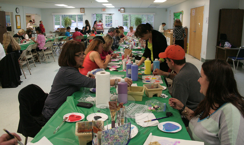 """Residents of all ages gathered in the hall at Newtown United Methodist Church on May 8 to paint ceramic hearts, part of the Hearts of Hope community support initiative. Newtown was introduced to Hearts of Hope in February, and now has a chance to pay it forward, sending hundreds of hand painted ceramic hearts with simple messages of caring to Boston.   (Hicks photo)<br /> <br /> PLEASE NOTE: Additional photos for this story, which were presented online in a slideshow, can be viewed here: <a href=""""http://newtownbee.smugmug.com/Journalism/Special-Events/With-Painted-Ceramic-Hearts/29588277_K95HcF/#!i=2530875896&k=GZVLFV6"""">http://newtownbee.smugmug.com/Journalism/Special-Events/With-Painted-Ceramic-Hearts/29588277_K95HcF/#!i=2530875896&k=GZVLFV6</a>"""