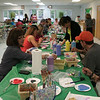 "Residents of all ages gathered in the hall at Newtown United Methodist Church on May 8 to paint ceramic hearts, part of the Hearts of Hope community support initiative. Newtown was introduced to Hearts of Hope in February, and now has a chance to pay it forward, sending hundreds of hand painted ceramic hearts with simple messages of caring to Boston.   (Hicks photo)<br /> <br /> PLEASE NOTE: Additional photos for this story, which were presented online in a slideshow, can be viewed here: <a href=""http://newtownbee.smugmug.com/Journalism/Special-Events/With-Painted-Ceramic-Hearts/29588277_K95HcF/#!i=2530875896&k=GZVLFV6"">http://newtownbee.smugmug.com/Journalism/Special-Events/With-Painted-Ceramic-Hearts/29588277_K95HcF/#!i=2530875896&k=GZVLFV6</a>"