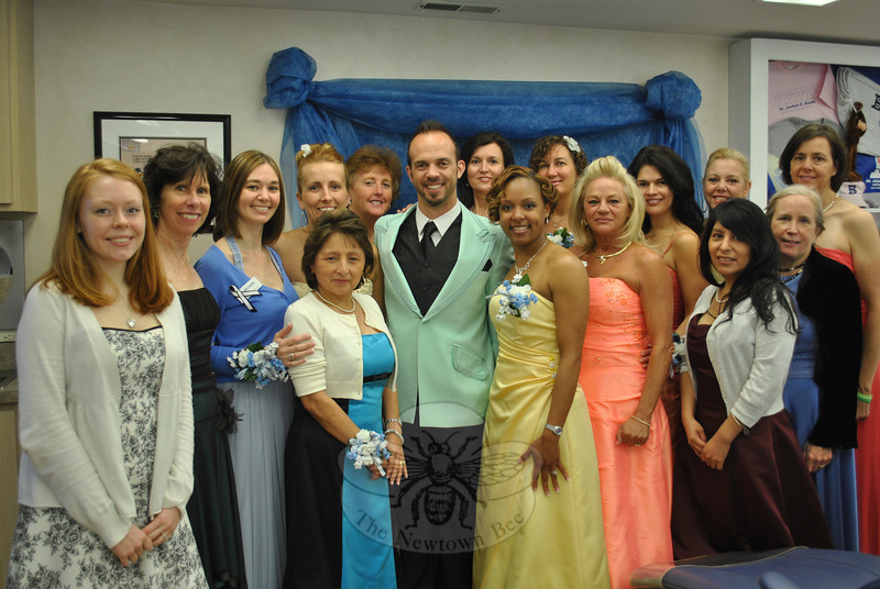 The staff and doctors at Dr Baum Orthodontics dressed up in prom attire (retro and otherwise) as one of many fun activities they do throughout the year to support their young clients. Friday, May 17, is the Newtown High School Senior Prom. Showing off their fashion attire in the group photo are staff members, from left, front, Taylor Smith, Patti McCusker, Michelle Morrison, Elizabeth Zarifis, Dr Baum, Nicky Kelley, Jewell Patrick, Jackie Lemieux, and Dr Elyse Koenig; back row, Veronica Feliciano, Kathy Lyddy, Sylviane Lamore, Laurel Butler, Monica Jimenez, Amy Ferris, and Jessica Meadows.   (Crevier photo)