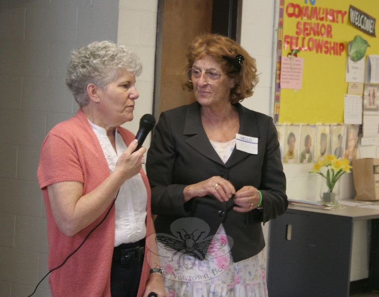 "CWU-Newtown/Greater Danbury member Linda Manganaro, left, presented a Valiant Woman Award to the Reverend Janice Touloukian. The associate pastor of Newtown Congregational Church for 20 years, Rev Touloukian will be ""celebrating her steps to a new future on June 1,"" said Mrs Manganaro. ""We have been blessed to have her as a pastor, and a friend, in the church and outside. We all wish you the best in your journey."" Rev Touloukian was caught completely by surprise at the award. She called it ""an honor I humbly accept.""  (Hicks photo)"