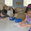 Joey Belisare and Grace Newsome, age 4, enjoy coloring in the spacious room at Misty Morning for preschool age children.  (Crevier photo)