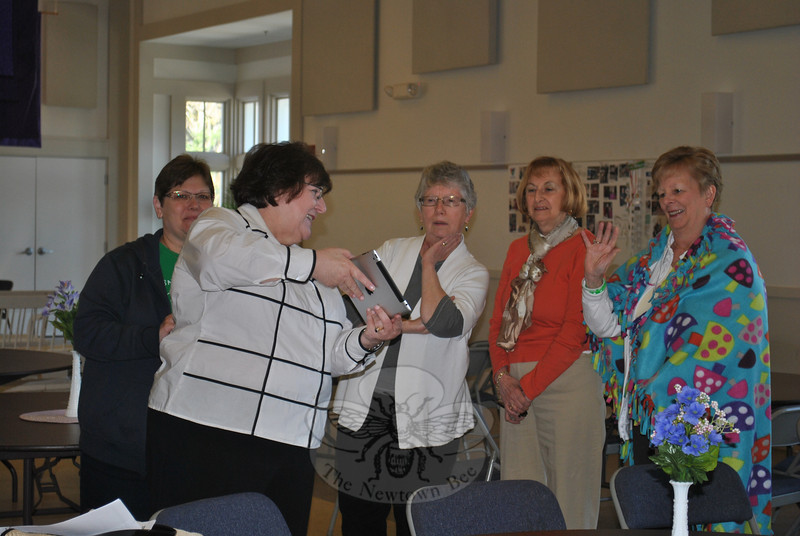 Members of the Newtown Woman's Club, GFWC, Inc converse via speakerphone with members of a sister GFWC group and a special needs class in northern Minnesota.     (Crevier photo)