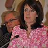 "An emotionally moved Laura Roche, a member of the Sandy Hook School Building Task Force, describes her visit earlier in the day with local firefighters, at the May 10 meeting. ""I'm proud of our community to come to this conclusion and the support of those who struggle with this decision,"" she said, following the vote to rebuild on the current SHS site.  (Crevier photo)"