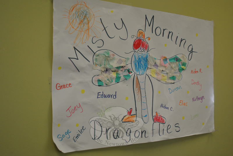 """Following its nature theme, all Misty Morning participants fall under the heading of """"Dragonflies,"""" as depicted and signed by kindergartners, in this poster.   (Crevier photo)"""
