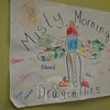 "Following its nature theme, all Misty Morning participants fall under the heading of ""Dragonflies,"" as depicted and signed by kindergartners, in this poster.   (Crevier photo)"