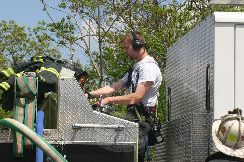 Botsford Fire Rescue First Lieutenant Patrick Keough worked the pump panel on Engine 551 during the May 12 call at the town's transfer station.   (Hicks photo)