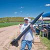 Michael Salvatore, treasurer of Connecticut Rocket Association, holds his rocket Back in Black, which he has launched more than 50 times.  (Dietter photo)