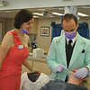 Dr Joshua Baum, of Dr Baum Orthodontics at 23 Church Hill Road, and assistant Jessica Meadows provide the royal treatment to a patient on Dr Baum Prom Day, Monday, May 13. The staff and doctors dressed up in prom attire (retro and otherwise) as one of many fun activities they do throughout the year to support their young clients. Friday, May 17, is the Newtown High School Senior Prom.  (Crevier photo)