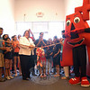 Representing both the Newtown Chamber of Commerce and Union Savings Bank, Peggy Velthuizen cut the ribbon for the official opening of the new Newtown Mathnasium, 266 South Main Street. With the math learning center owners, Vivek Subramanian and Geetha Rajgopalan, and many others in attendance, the day offered a chance to visit, enjoy snacks, and take a tour of the facility.  (Hallabeck photo)