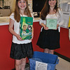 RIS student Audrey Christensen, left, and her mother, Nicole Christensen, stand next to one of two collection boxes they have set up in town. Audrey, an animal lover, is collecting donations of pet food, cat litter, and leashes that will be sent to the tornado ravaged Moore, Okla., area via Connecticut Truck to Oklahoma, later this month.    (Crevier photo)